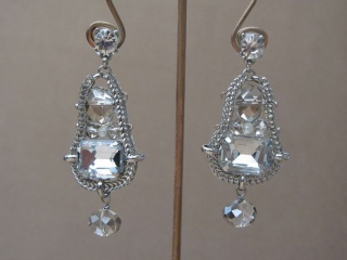 Clear Crystal Cut Earrings in a Woven Silver Tone Surround