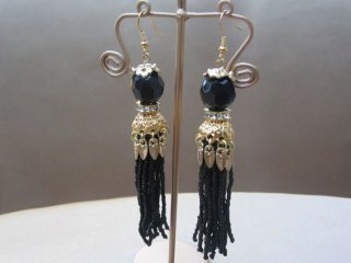Long Black Tassel Drop Earrings Encased in an Ornate Gold Setting
